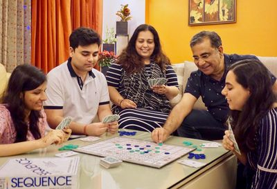 Sanjay enjoying time with his family playing board games.