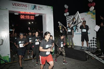 Neelakandan (right hand side podium) starting the VRun Race, Pune, India
