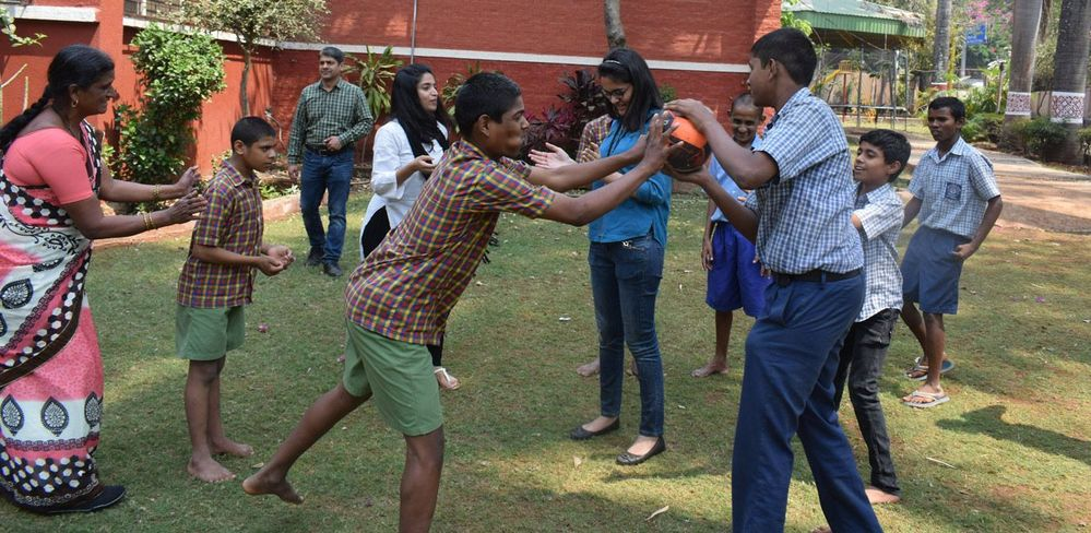"""The Veritas Pune HR team spent the afternoon engaging the children at Bal Kalyan Sanstha in activities, like """"Blast the Balloon,"""" which they imagined alongside the students."""