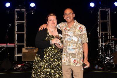 Fabienne Daniels receives her Club VIP Award from Lenny Alugas