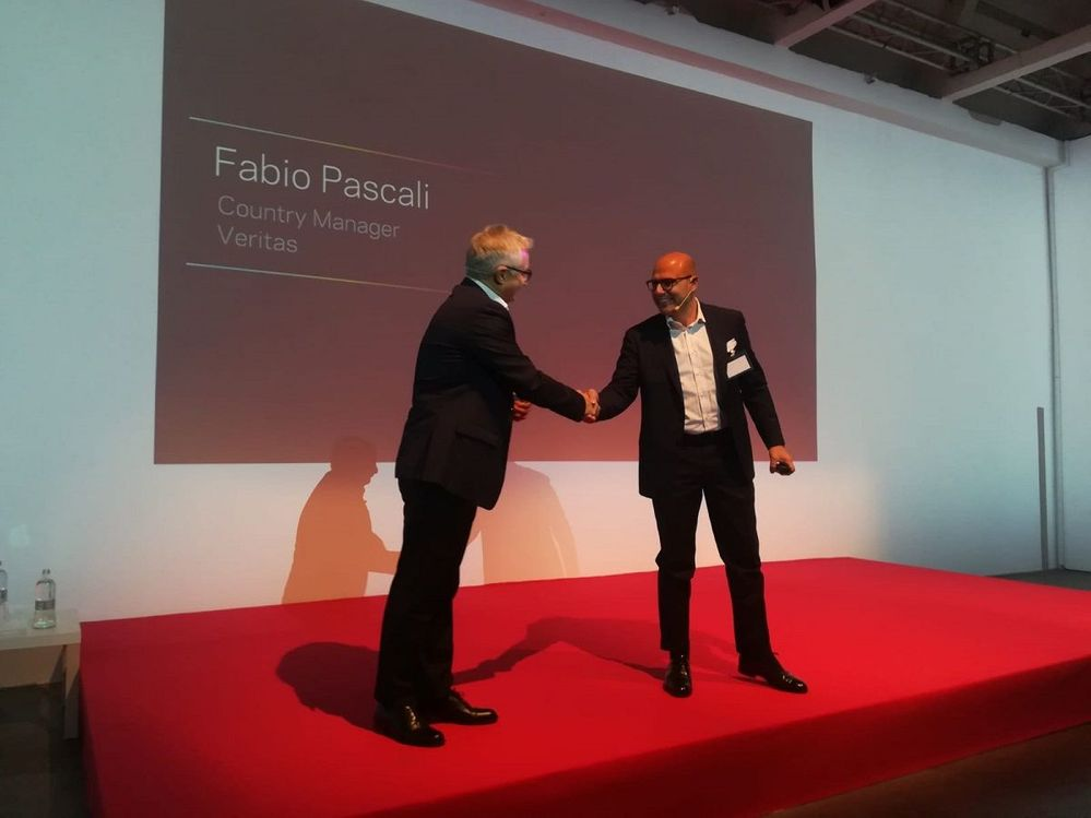Fabio Pascali (right) welcomes Ezio Viola (left), Managing Director, The Innovation Group to the stage.