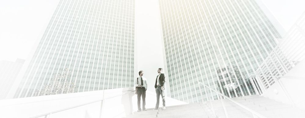 Two business men under highrise buildings_07.jpg