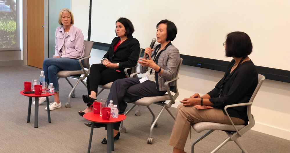 Jane Zhu, seated alongside Veritas colleagues invested in leading WAVE, speaking with session attendees on workplace best practices.