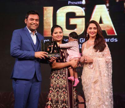 Varun and his family accepting an IGA Award