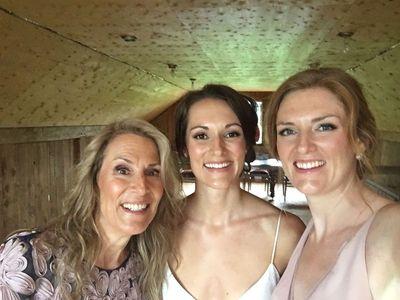 Garth's Spouse; Lori (left) and his daughters Lauren and Megan