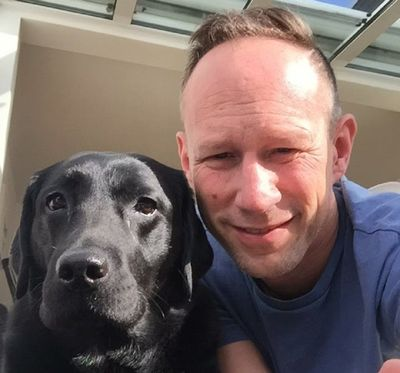7C417C88-37CC-4EE3-85F2-CC685A571892 Sascha and his dog.jpg