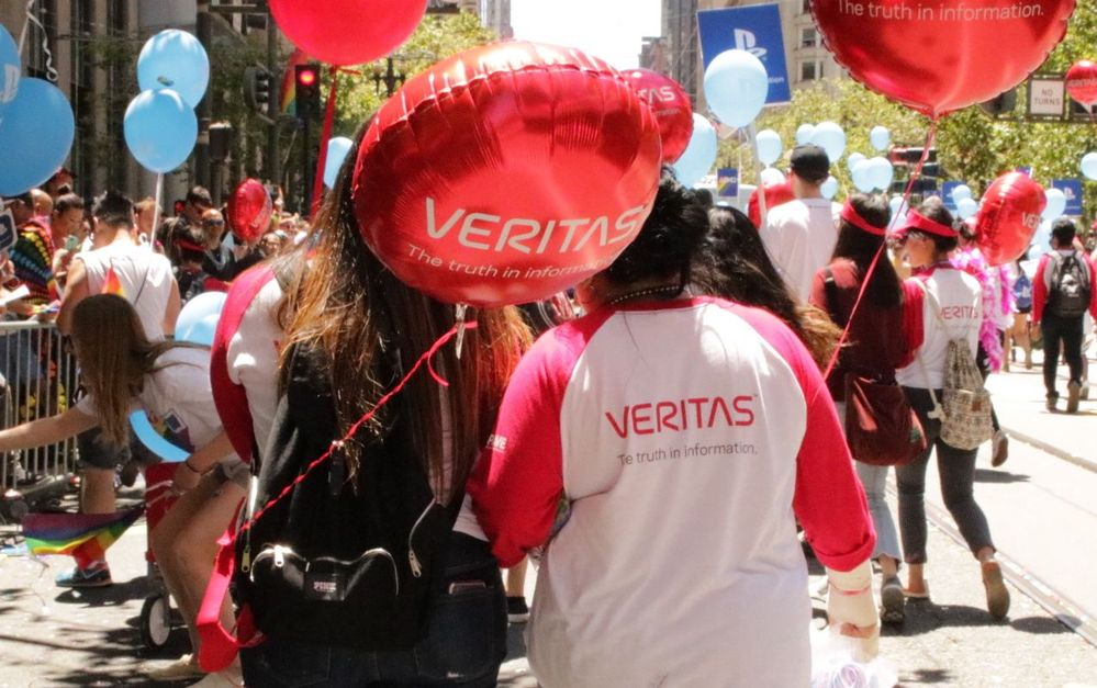 Members of #TeamVtas marching in the Pride Parade route before the Veritas double-decker bus.