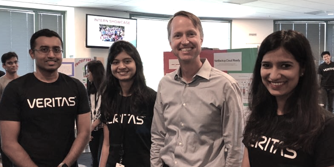 Veritas University interns with CEO, Greg Hughes, during the Innovation Pod showcase.