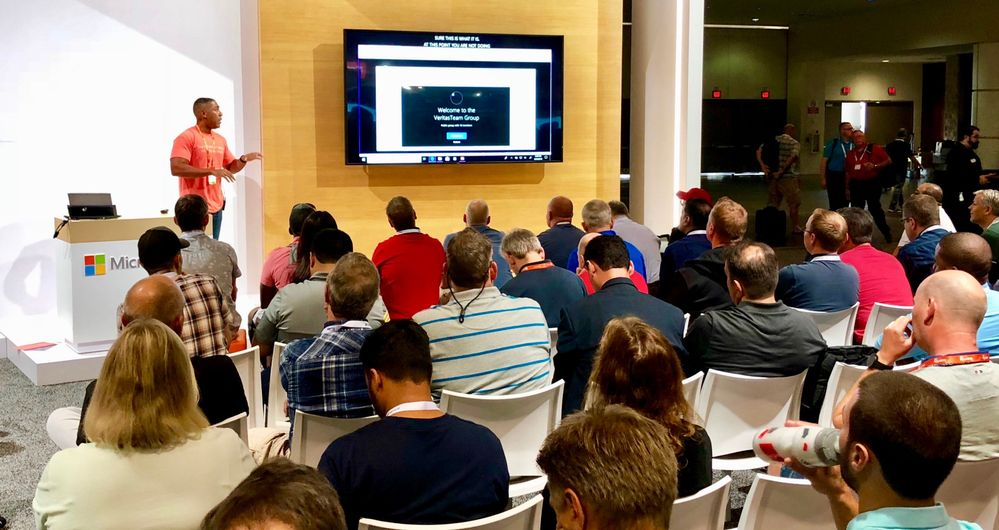 Presenting on the benefits of Veritas data management and protection solutions at MS Ignite 2018 to a crowd of event attendees.