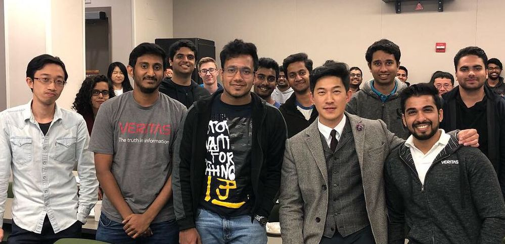 Yoon Chung, Veritas CX Director of Program Management, shares a photo opportunity with students attending the Veritas Technologies information sessions.