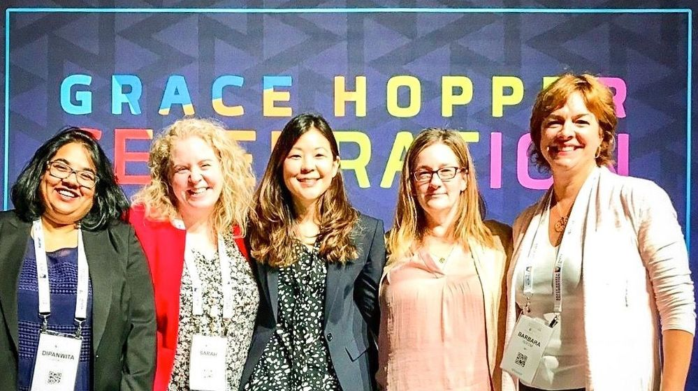 Members of #TeamVtas gather for a group photo at this year's Grace Hopper Conference, including presenter, Veritas Director of Finance, Sarah Byrne, second from left..
