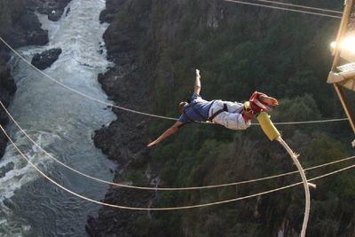 Wahid bungee jumping off Victoria Falls, Zimbabwe