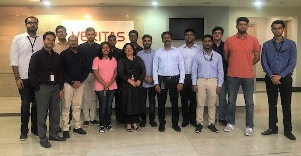 The group joins to take a photo together following a day of networking at Veritas India.