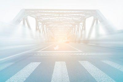 Traffic-through-bridge-with-blur-trail.jpg