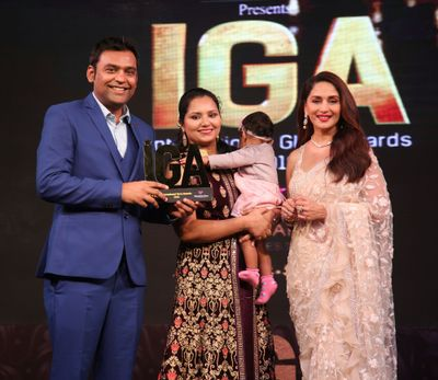 Varun and his family accepting an IGA Award